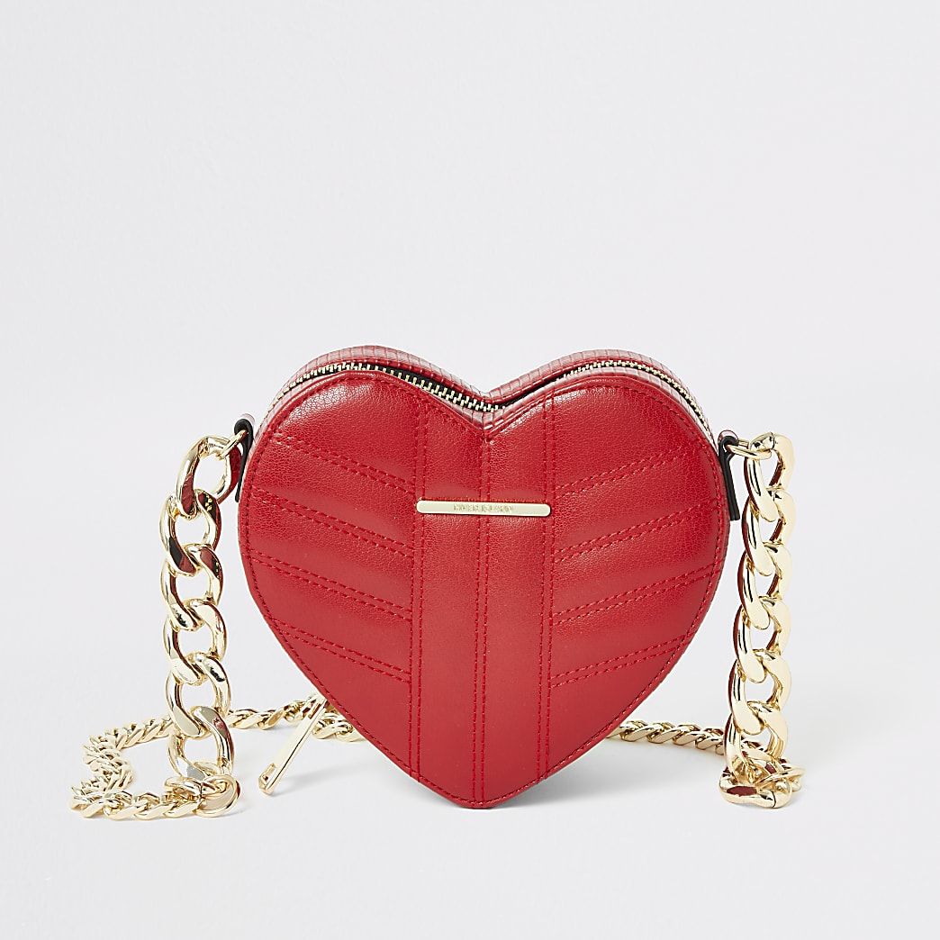 Red quilted heart shaped cross body bag