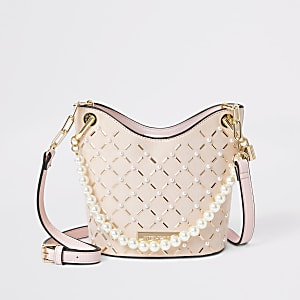 Roze crossbodybuckettas met studs en parels