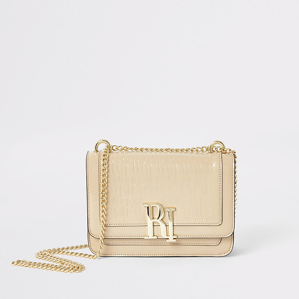 Cream patent RI embossed cross body bag
