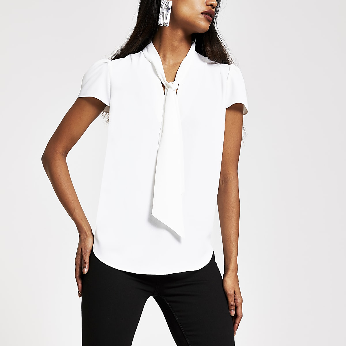 Petite white short sleeve tie neck blouse
