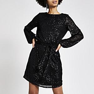 Zwarte jurk met strikceintuur verfraaid met lovertjes