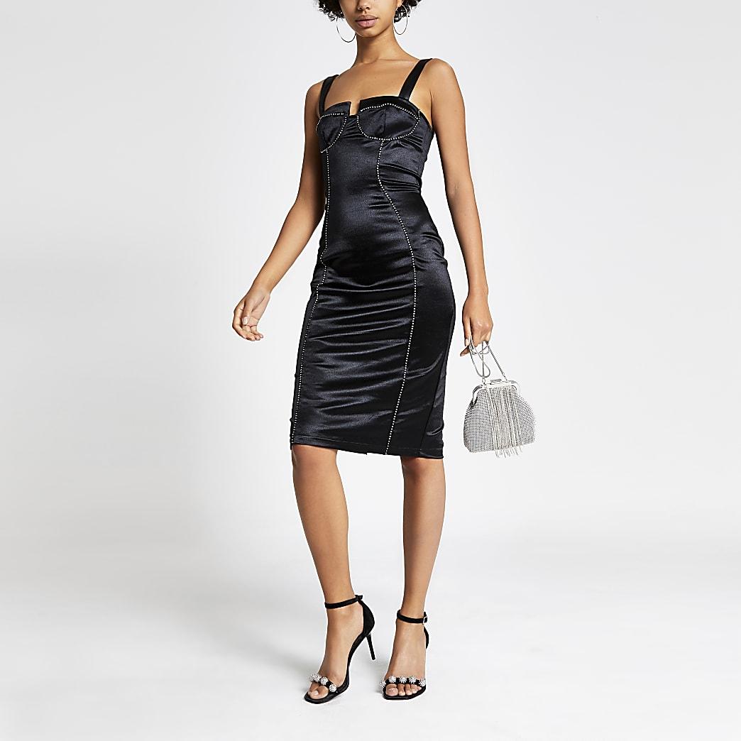 Robe moulante noire en satin effet corset ornée