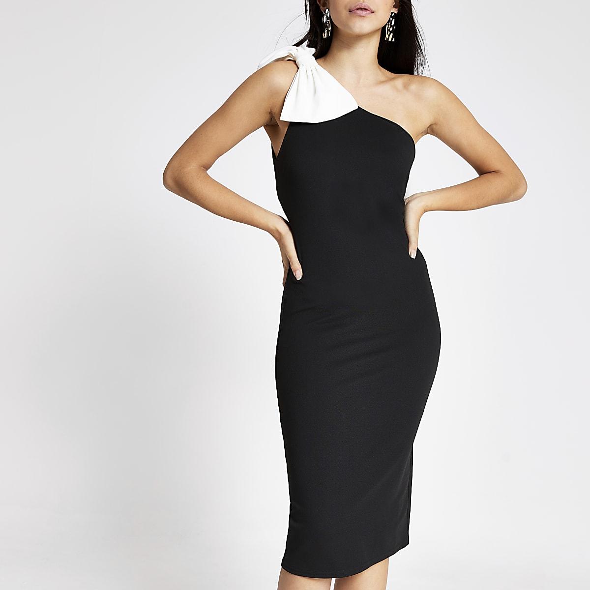 Zwarte midi-jurk met ontblote schouder en contrasterende strik
