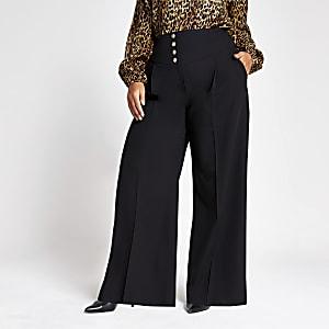 RI Plus - Zwarte broek met korsettaille en wijde pijpen