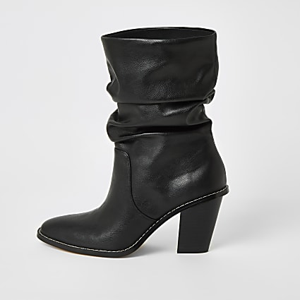 Black heeled slouch boots