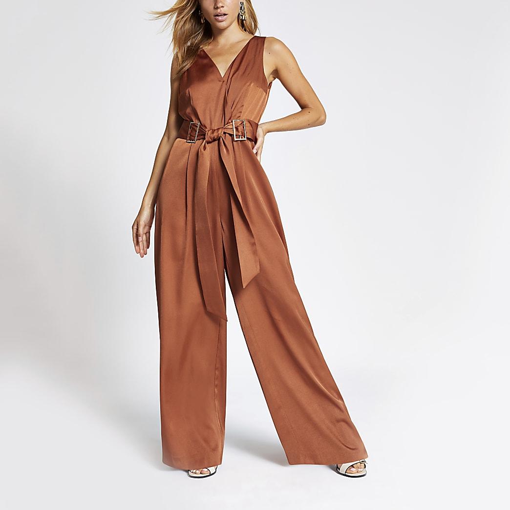 Donker oranje V-hals jumpsuit met ceintuur op de taille