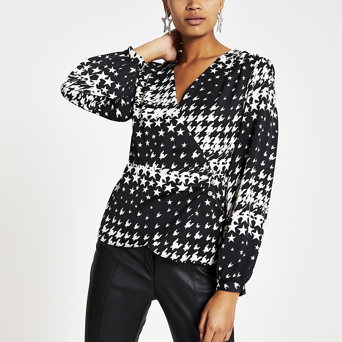 Black star print long sleeve wrap blouse
