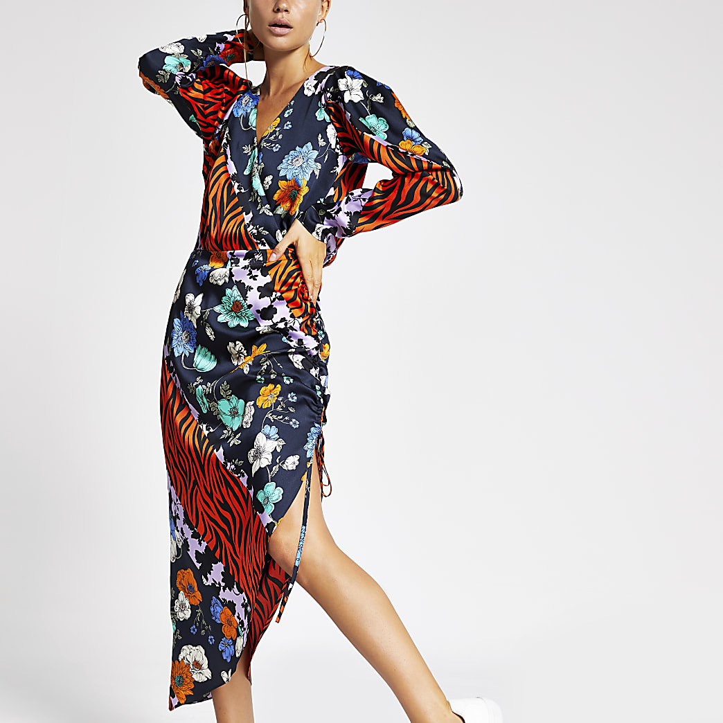 Oranje midi-jurk met overslag en bedrukt