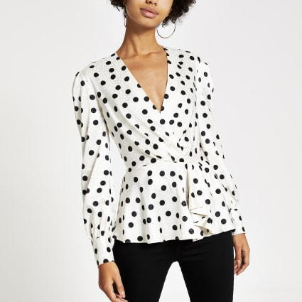 White polka dot wrap peplum top