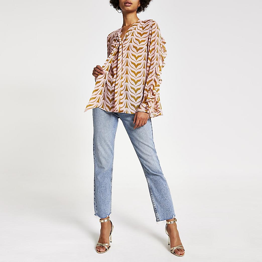 Roze blouse met print en strik aan de hals