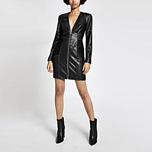 Zwarte mini-jurk van imitatieleer met contrasterend stiksel