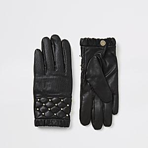 Zwarte leren handschoenen met perforaties en studs