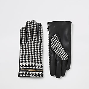 Schwarze Handschuhe mit Hahnentritt-Muster und Kettchen