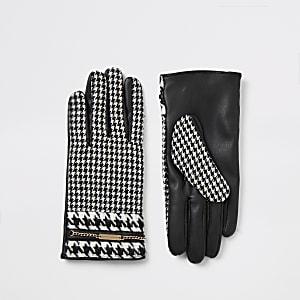Zwarte handschoenen met pied-de-poule-ruiten en verfraaid met ketting