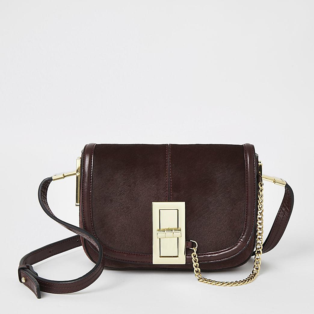 Purple leather lock front cross body bag