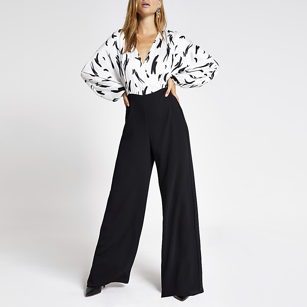 White printed long sleeve wide leg jumpsuit
