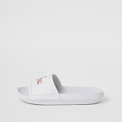 Lacoste white brand embossed sliders