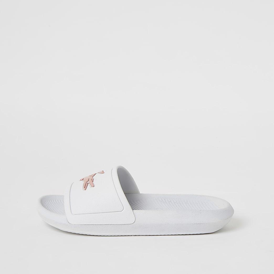 Lacoste white brand embossed sliders