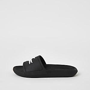 Lacoste – Schwarze Badeschlappen mit Markenprägung