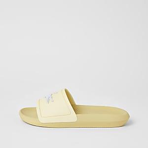 Lacoste – Gelbe Badeschlappen mit Markenprägung