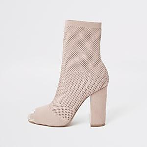 Pinke Sock-Stiefel mit Lochstrickmuster und weiter Passform
