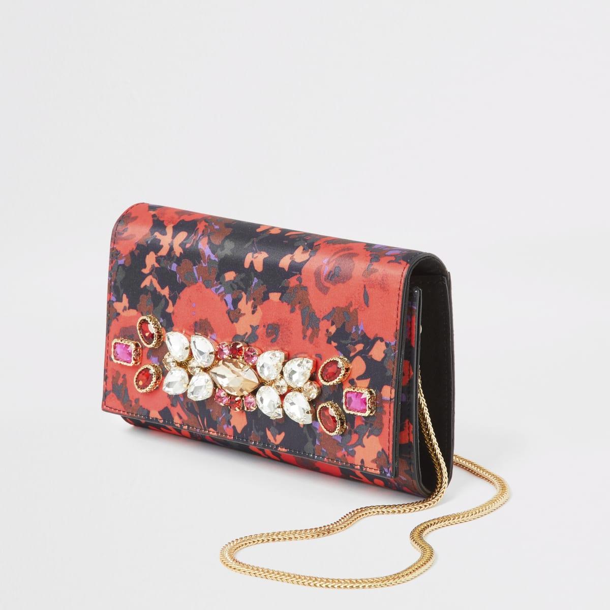Rote Handtasche mit Blumenprint und Schmucksteinverzierung