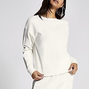 RI Petite - Crèmekleurig sweatshirt met siersteentjes op mouwen
