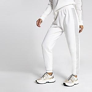 Cremefarbene Jogginghosen mit strassverzierten Seiten