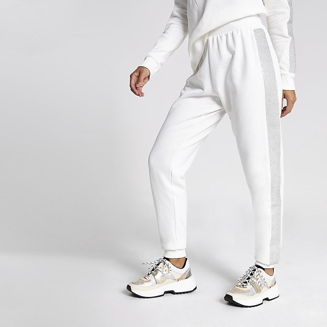 Crèmekleurige joggingbroek verfraaid met siersteentjes