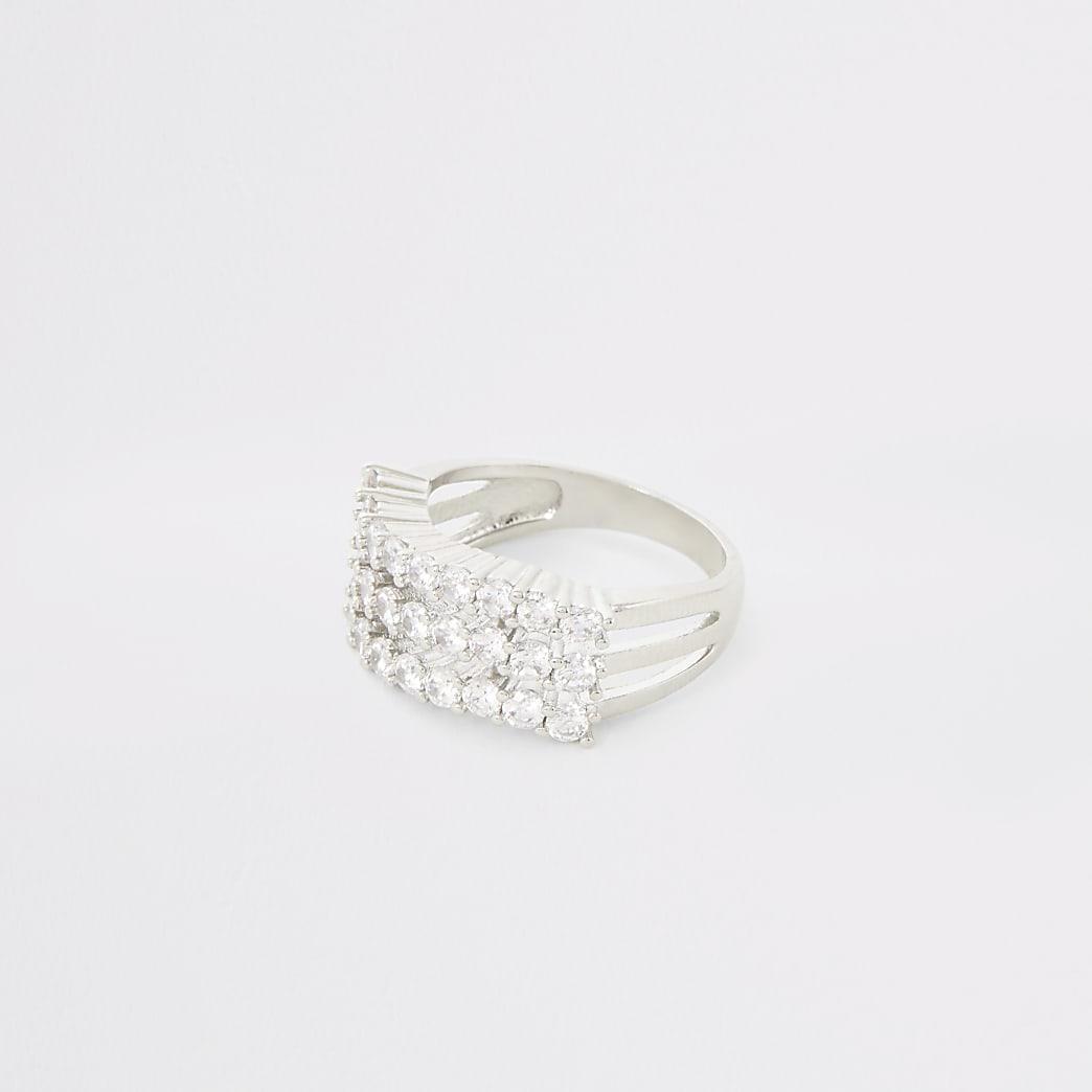 Zilverkleurige ring met drie rijen met siersteentjes