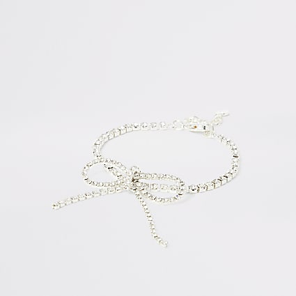 Silver colour bright diamante bow bracelet