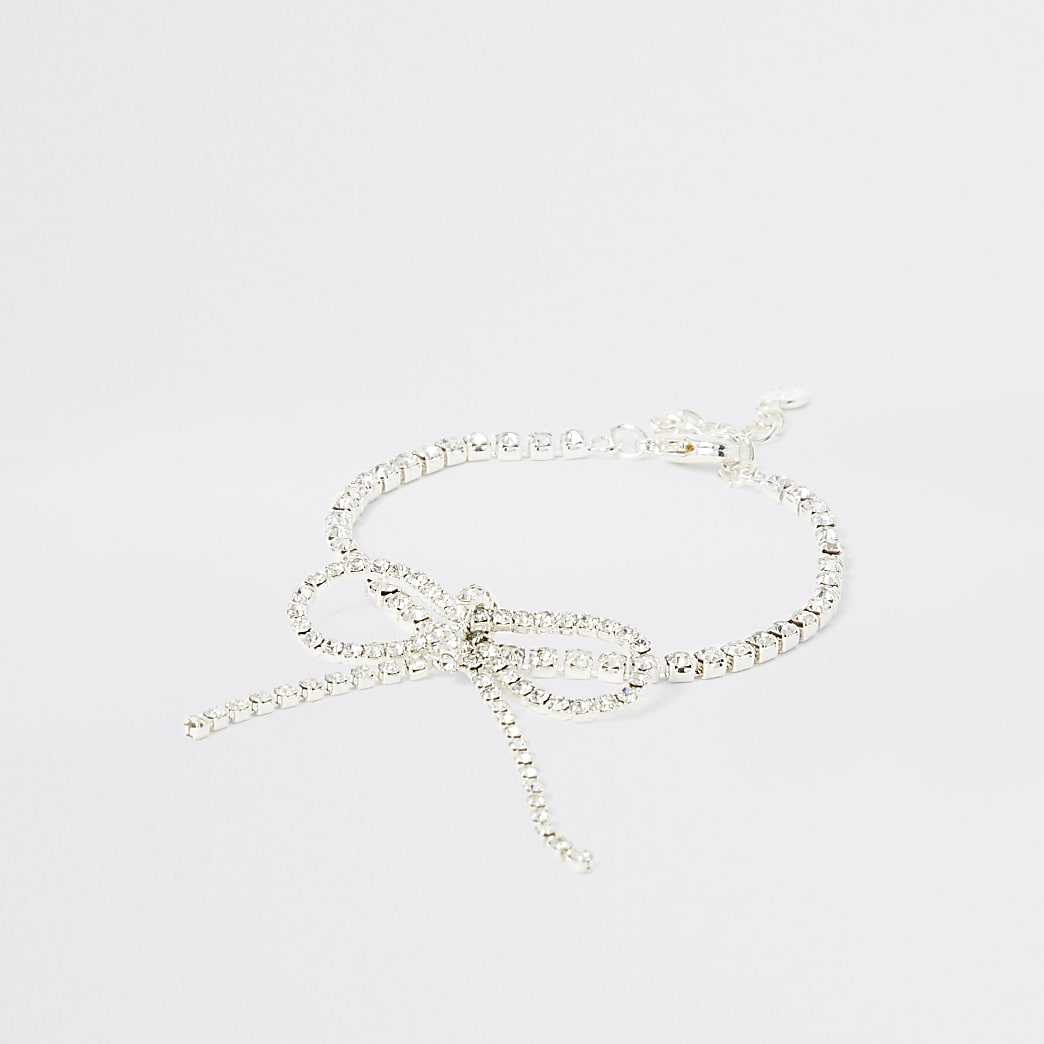 Silver colour bright diamante bow bracelet
