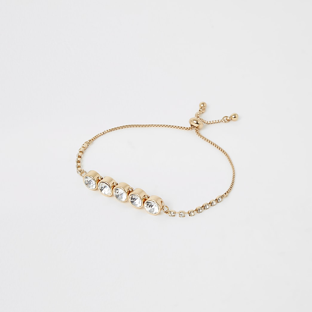 Bracelet doré avec pierreries et strass