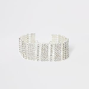 Zilverkleurige armband bezet met siersteentjes