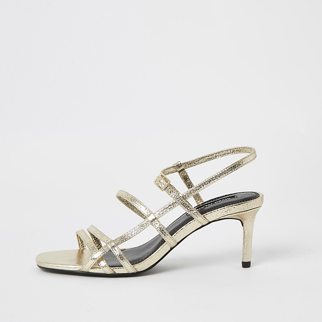 Goudkleurige metallic sandalen met smalle hak en bandjes