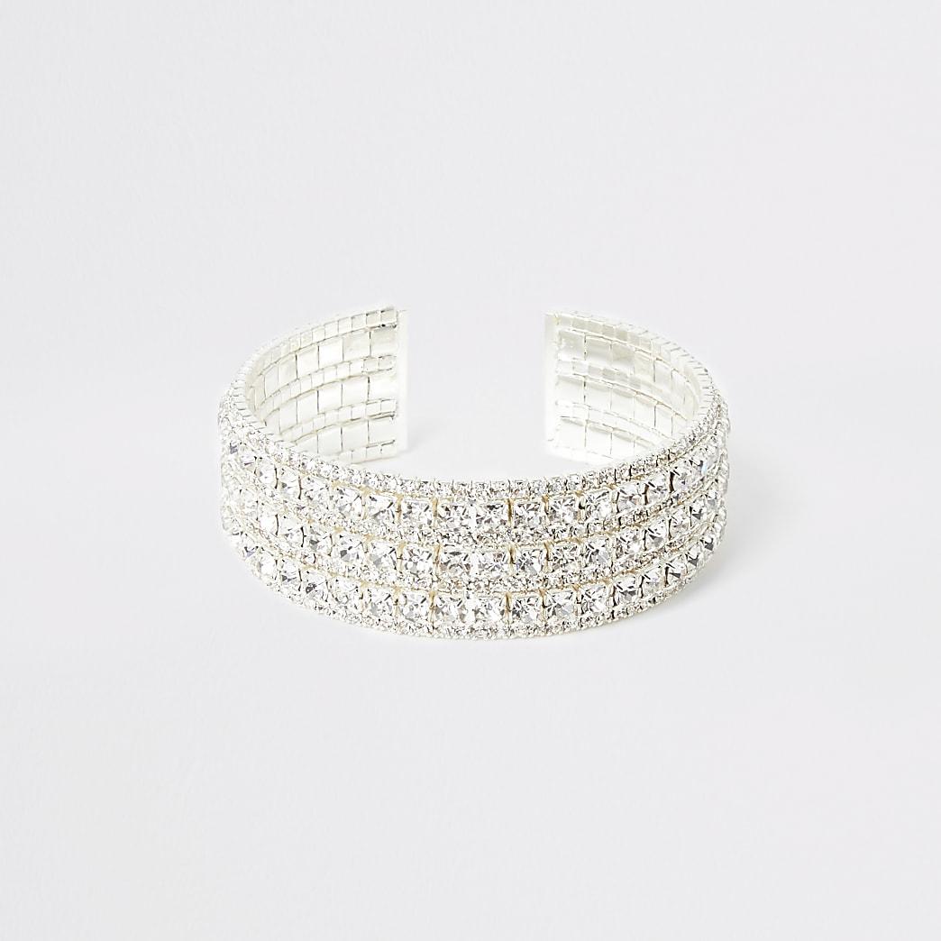 Zilverkleurige brede armband met siersteentjes