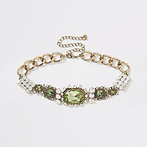 Green ornate jewel statement necklace