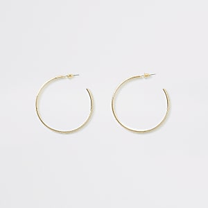Goudkleurige oorringen met halve cirkel en glitter