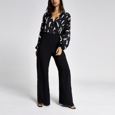 Petite black printed wrap jumpsuit