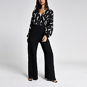 RI Petite - Zwarte jumpsuit met overslag en print