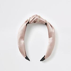 Beige hoofdband met knoop omringd met siersteentjes