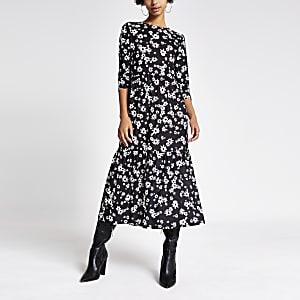 Schwarzes gesmoktes Kleid mit Blumenmuster