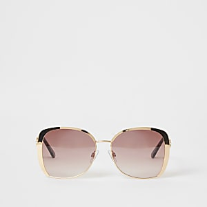 Goudkleurige oversized zonnebril met roze glazen