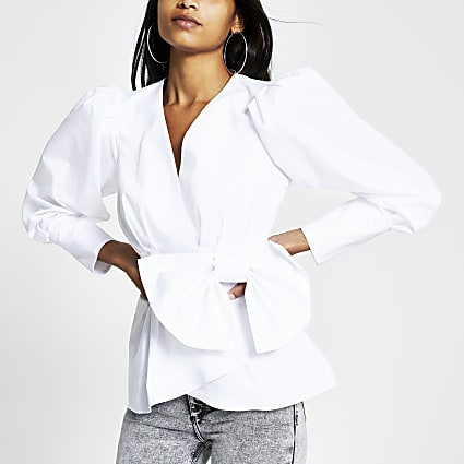 White wrap bow peplum blouse