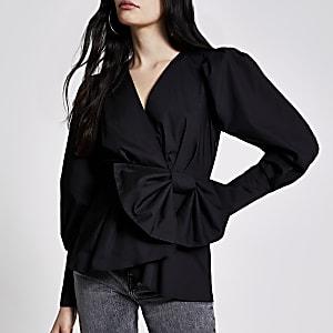 Zwarte blouse met peplum, overslag en strik