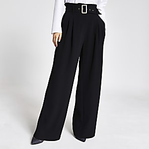RI Petite - Zwarte broek met ceintuur en wijde pijpen