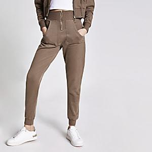 Braune, hoch geschnittene Jogginghose mit Frontreißverschluss