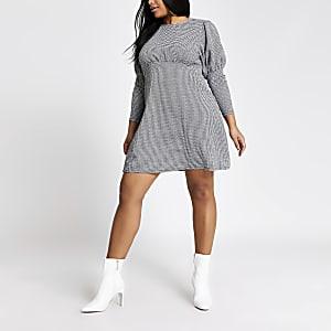 RI Plus - Zwarte mini-jurk met pied-de-poule motief en pofmouwen