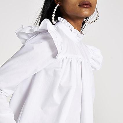 Petite white ruffle shoulder blouse