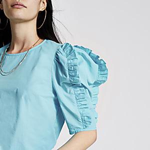 Helderblauwe blouse met korte poplinmouwen met ruches